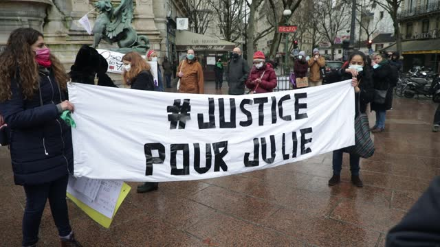 "protesters hold a banner on which we can read ""justice for julie"" during a demonstration of feminist collectives on february 7, 2021 in paris,... - partisan politics stock videos & royalty-free footage"