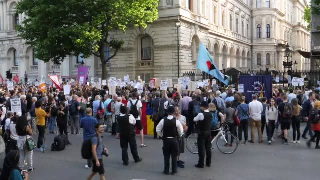 Protesters hold a demonstration outside the Home Office calling for British Prime Minister Theresa May to resign and justice for victims of the...