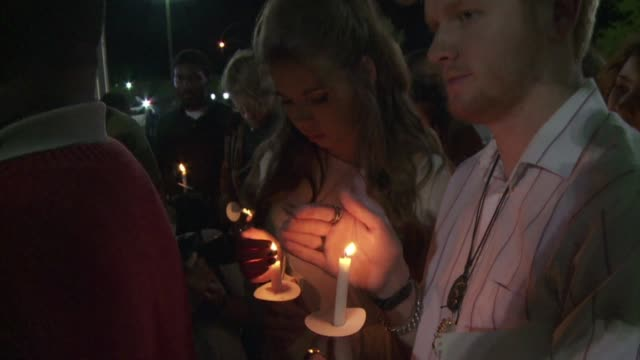 Protesters hold a vigil outside the North Charleston City Hall after the latest in a series of police killings of black suspects is caught on video...