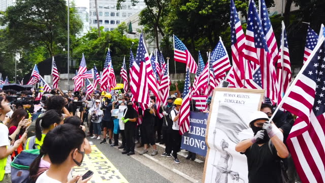 protesters hold american flags as they walk through central district during a march to petition the us consulate on september 8, 2019 in hong kong,... - 8 9 years stock videos & royalty-free footage