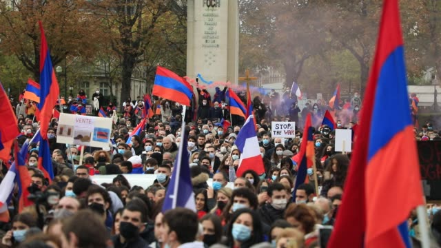 protesters hold armenian flags during a demonstration organized by the cooperation council of armenians of france to demand recognition of the... - osteuropäische kultur stock-videos und b-roll-filmmaterial
