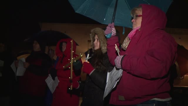 WXIN Protesters Hold Crosses After ACLU Sues for Christmas Tree Cross Display in Knightstown Indiana on Dec 11 2016 The ACLU filed a suit against...