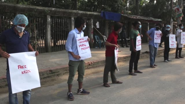 protesters hold placard in front of national press club in dhaka bangladesh on tuesday may 5 as they demand release of a bangladeshi journalist... - trespassing stock videos & royalty-free footage