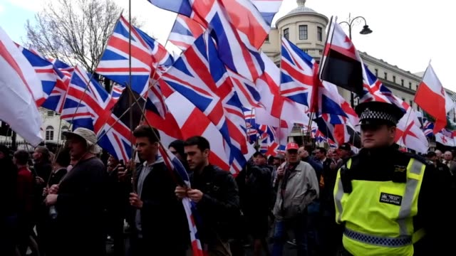 protesters hold placards and british union jack flags during a protest titled 'london march against terrorism' in response to the march 22... - organised group photo stock videos & royalty-free footage