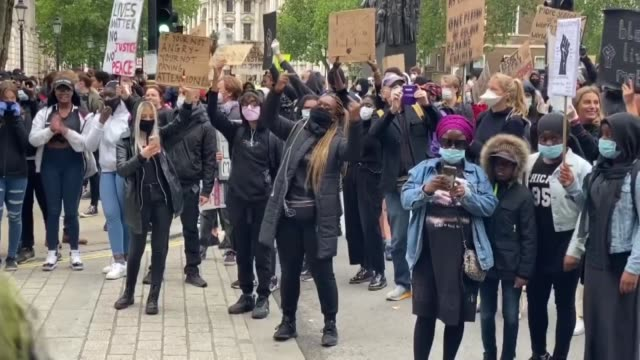protesters hold placards as they attend a demonstration outside downing street in central london on june 6 to show solidarity with the black lives... - togetherness stock videos & royalty-free footage