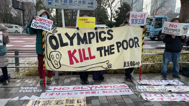 protesters hold placards during a demonstration calling for the tokyo olympics to be cancelled on february 12, 2021 in tokyo, japan. tokyo 2020... - tokyo japan stock videos & royalty-free footage