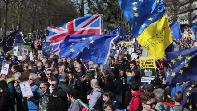 protesters hold placards in front of nelson's column in trafalgar square during a unite for europe march to protest brexit in central london, u.k.,... - 2016 video stock e b–roll