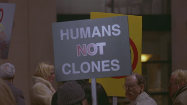 protesters hold signs protesting human cloning. - cloning stock videos & royalty-free footage