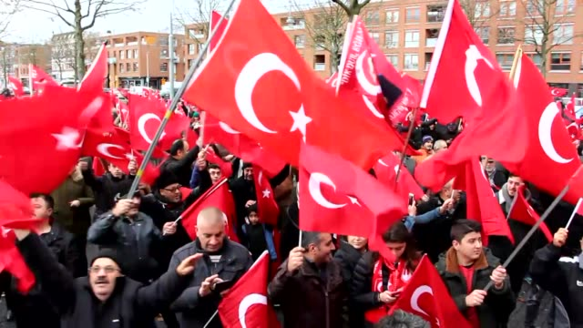Protesters hold Turkish flags during the ''Curse the Terror Invite Democracy'' rally against PKK terrorist organization at Afrikaanderplein square in...