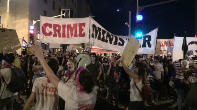 """protesters hold up a large banner which reads """"crime minister"""" and shout slogans during a demonstration attended by over 15,000 people gathered... - eddie large stock videos & royalty-free footage"""