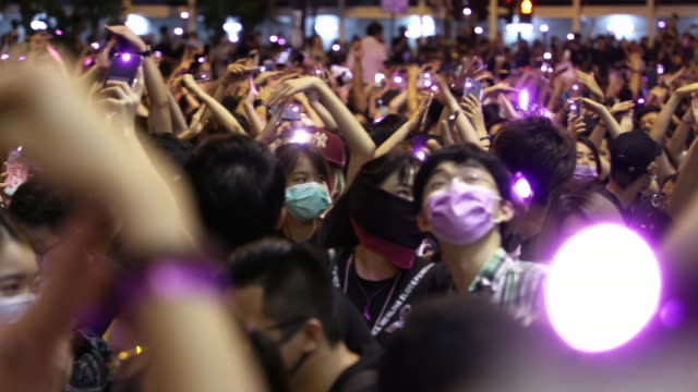 protesters hold up lights from their mobile phones during a protest in hong kong over alleged instances of sexual violence during the ongoing... - handheld stock videos & royalty-free footage