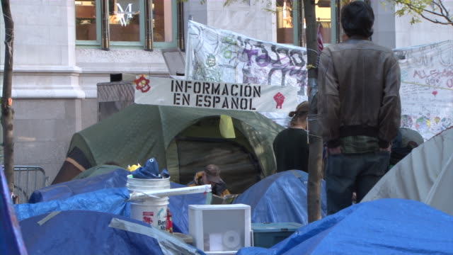 protesters holding zuccotti park during occupy wall street movement audio / new york city, new york, united states - occupy protests stock videos & royalty-free footage