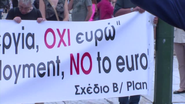 protesters in athens call on greeks to vote no in a referendum announced for the latest reform proposals from creditors after bailout talks collapsed... - referendum stock-videos und b-roll-filmmaterial