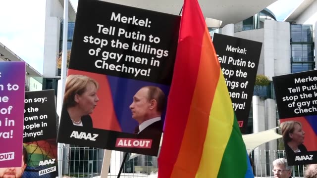 Protesters in Berlin call on German Chancellor Angela Merkel to raise the issue of gay rights with Russian President Vladimir Putin when the pair...