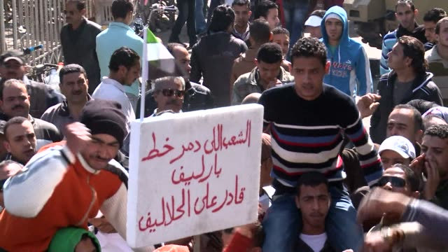 protesters in egypts troubled city of port said tried to close down a portion of the vital suez canal waterway clean protesters try to close down... - port said stock videos & royalty-free footage