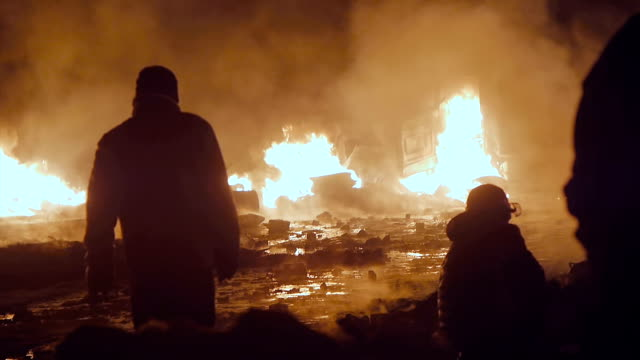 stockvideo's en b-roll-footage met protesters in front of burning vans - puin
