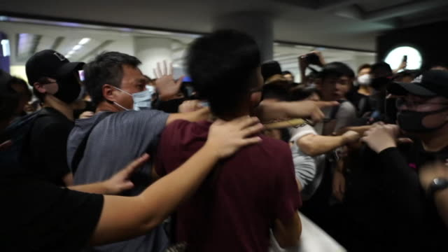 protesters in hong kong clashing with alleged 'infiltrators' during an occupation of the airport - hong kong international airport stock videos & royalty-free footage