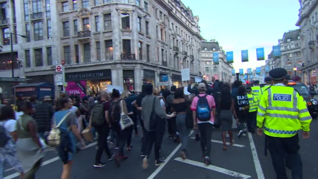 protesters in london holding up signs and chanting black lives matter in a display of solidarity for victims of police shootings in the usa - 犠牲者点の映像素材/bロール