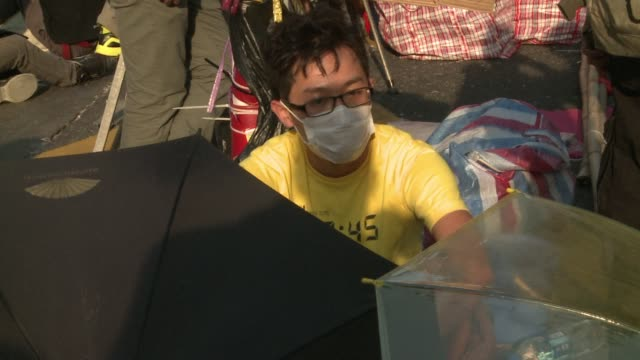 protesters in mongkok one of hong kongs busiest shopping districts say they plan to stay until the last minute as a deadline for pro democracy... - time's up social movement stock videos and b-roll footage