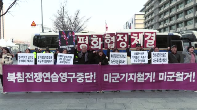 protesters in seoul call for the withdrawal of us troops from south korea ahead of a summit between us president donald trump and north korean leader... - donald trump us president stock videos and b-roll footage