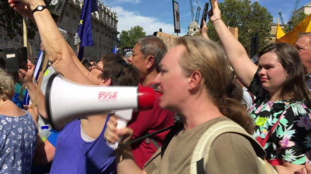 protesters in westminster chanting if you shut down our parliament we'll shut down the streets after boris johnson's decision to prorogue parliament - sprechgesang stock-videos und b-roll-filmmaterial