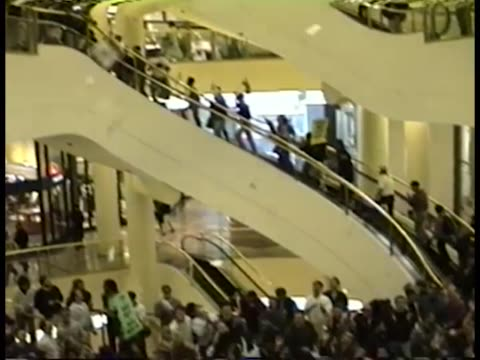 stockvideo's en b-roll-footage met protesters inside of a shopping mall during a unity rally for act up during the 6th annual international aids conference - nordstrom