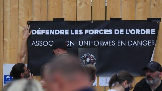 protesters install a banner on which is written defend the police during the collective ffoc rally in support of the police force on june 27 2020 in... - femininity stock videos & royalty-free footage