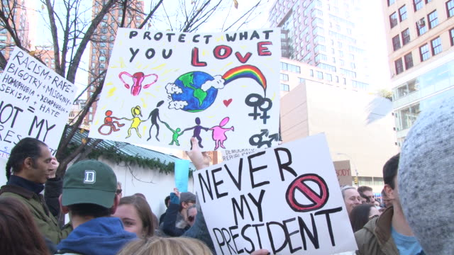 protesters join voices in chanting antitrump messages / cu on signs protesters created for the event - us republican party 2016 presidential candidate stock videos & royalty-free footage