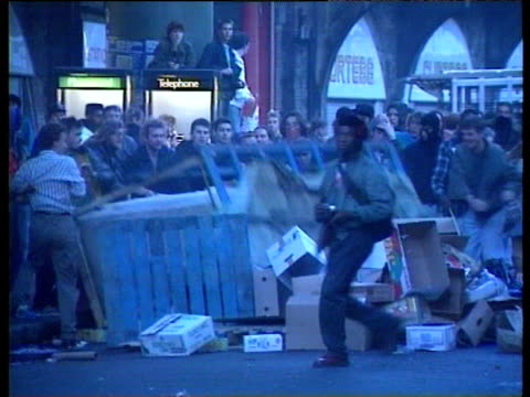 protesters knock over market stall to make barricade during london poll tax demonstrations 20 oct 90 - market stall stock videos & royalty-free footage