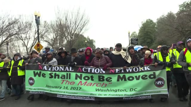 protesters led by reverend al sharpton brave the rain to join the we shall not be moved march in washington just five days ahead of the inauguration... - al sharpton stock videos & royalty-free footage