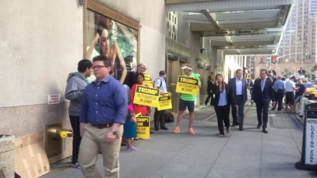 protesters line up by the waldorf astoria for the donald trump mike pence event - waldorf astoria stock videos & royalty-free footage