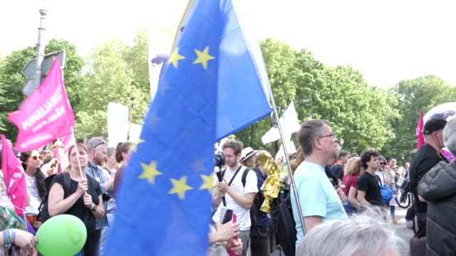 """protesters listen to the speech of an afghan refugee and take part in the """"one europe for all"""" march on may 19, 2019 in berlin, germany. thousands of... - populism stock videos & royalty-free footage"""