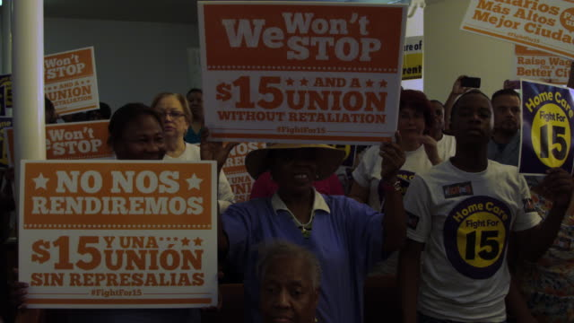 protesters make themselves heard on tax day asking for higher wages on april 15, 2015 in miami, florida. fast food workers in cities around the... - high up stock videos & royalty-free footage