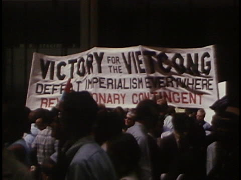 protesters march and attend rallies to end the vietnam war. - anno 1968 video stock e b–roll