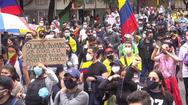 protesters march and chant against the tax reform made by the national government on may 1 bogotá, colombia. thousands of colombians demonstrated for... - colombia stock videos & royalty-free footage