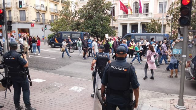 protesters march and chant slogans during a demonstration, in the vallecas neighborhood, against the measures imposed by the capital's regional... - number 2 stock videos & royalty-free footage