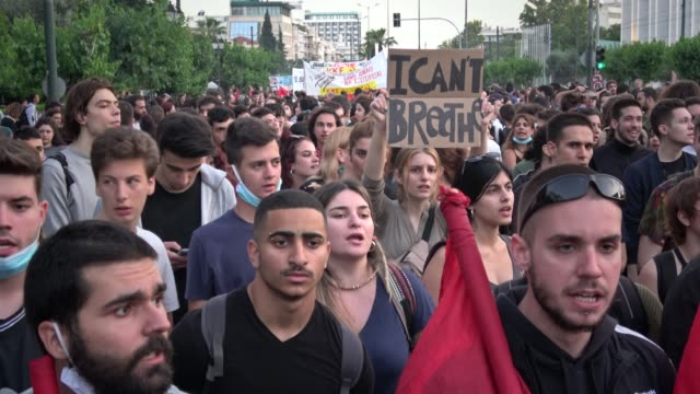protesters march at the us embassy in athens greece on june 3 in solidarity with american demonstrators rallying over the death of george floyd who... - i can't breathe stock videos & royalty-free footage