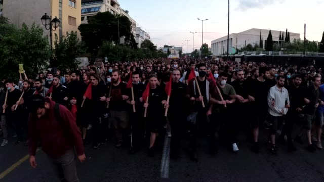 protesters march at the u.s. embassy in athens, greece, on june 3 in solidarity with american demonstrators rallying over the death of george floyd... - large group of people stock videos & royalty-free footage