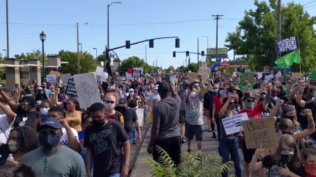 protesters march down martin luther king jr boulevard during a black lives matter march on august 01 2020 in portland oregon the daylight rally came... - portland oregon video stock e b–roll