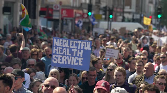"""protesters march down oxford street during a """"unite for freedom"""" anti-lockdown demonstration held to protest against the use of vaccine passports in... - slow motion stock videos & royalty-free footage"""