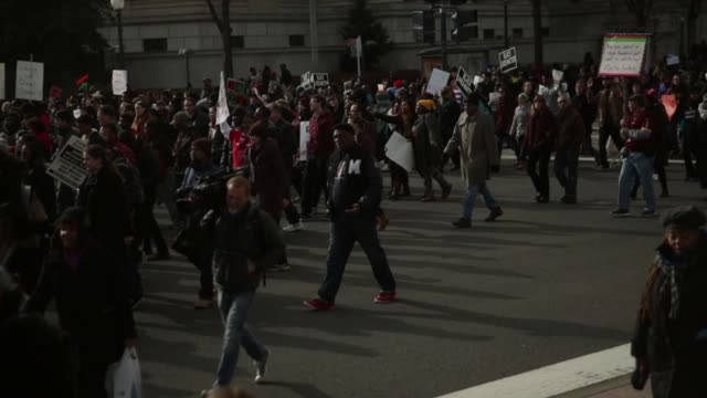 protesters march from freedom plaza to capitol hill december 13 washington dc thousands of people gather in the nation's capital for the 'justice for... - freedom plaza video stock e b–roll