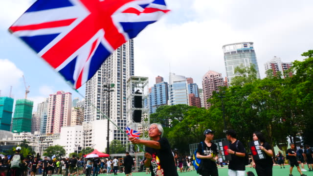 protesters march in a mass protests rally from victoria park to government complex in hong kong. estimated 2 million people attended the anti... - hong kong flag stock videos & royalty-free footage