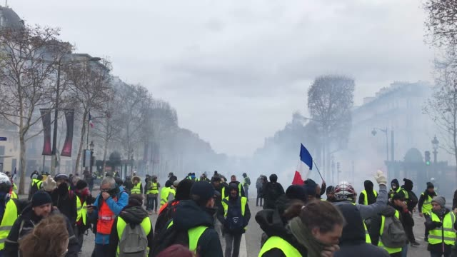 Protesters march in the 'yellow vests' demonstration near the Arc de Triomphe on December 8 2018 in Paris France ''Yellow Vests' is a protest...