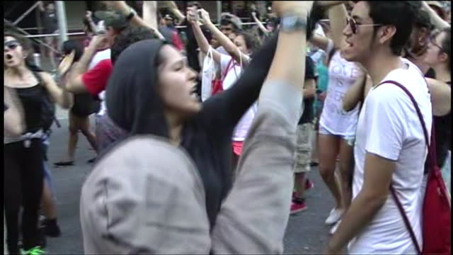 protesters march in times square new york city after george zimmerman is acquitted for the murder of trayvon martin - unschuld stock-videos und b-roll-filmmaterial