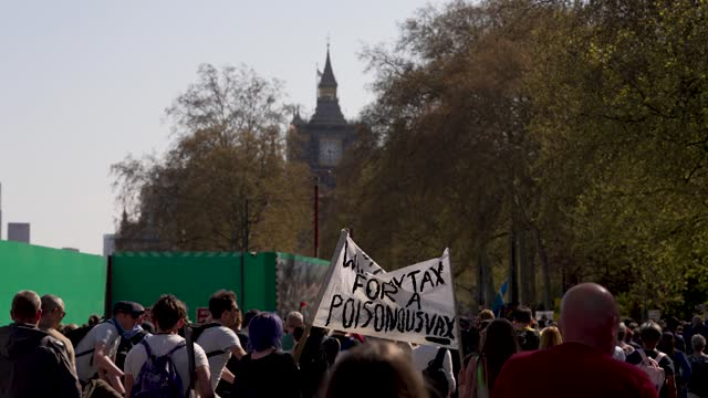 """protesters march near big ben, houses of parliament during a """"unite for freedom"""" anti-lockdown demonstration held to protest against the use of... - tower stock videos & royalty-free footage"""