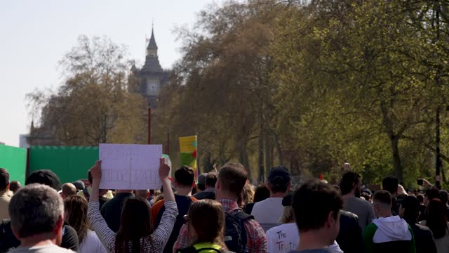 """protesters march near big ben, houses of parliament during a """"unite for freedom"""" anti-lockdown demonstration held to protest against the use of... - clock tower stock videos & royalty-free footage"""