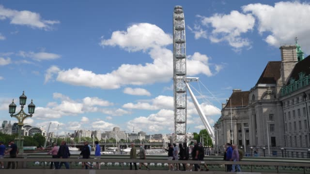 protesters march on westminster bridge with the london eye in the background on june 13 2020 in london united kingdom following a social media post... - big wheel stock videos & royalty-free footage
