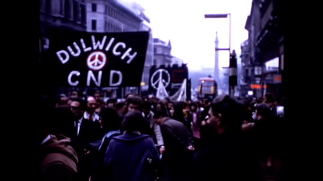 cnd protesters march past the cenotaph / cars drive past ban the bomb cnd banners including dulwich stepney bethnal green / a man holds the end is at... - aldermaston stock videos & royalty-free footage