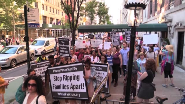 protesters march through washington square park on way to ice headquarters to protest trump/pence immigration detentions on border and shipping... - detainee stock videos and b-roll footage