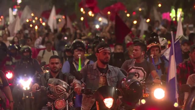 Protesters marched on the streets of Tegucigalpa Friday night towards the United States Embassy carrying torches and banners against current...